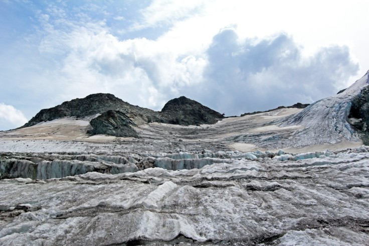 Photo of the Glacier de Piece on the northern approach to the Cabane des Vignettes from Arolla. The hut's heli pad is visible with a helicopter on it on the skyline right of centre