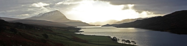 Photo of an early afternoon view south down Loch Hope from Hope to Ben Hope and the Strath More hills of Sutherland