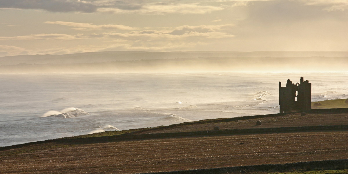 Photo of Keiss Castle perched at the north end of Sinclair's Bay north of Wick