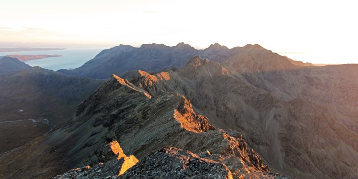 Photo of evening slanting sun light streaming across the Black Cuillin ridge south of Bruach na Frithe.