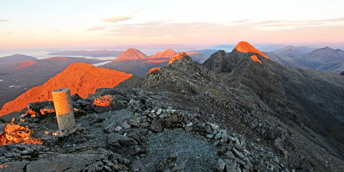 Photo of setting sunlight highlighting the peaks of the northern Black and Red Cuillin from Bruach na Frithe at the end of a perfect October day