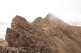 Photo of a sepia view of the Bhasteir Tooth, Am Basteir and Sgurr nan Gillean from Sgurr a' Fionn Choire at the northern end of the Cuillin ridge on Skye