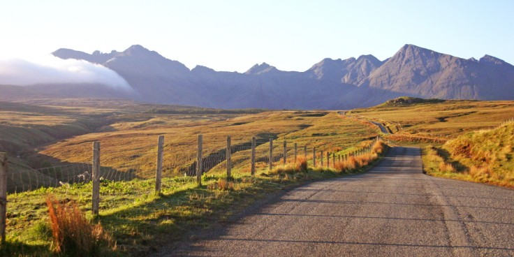Photo of an early morning view along the road into Glen Brittle on Skye with the peaks of the Cuillin beyond.
