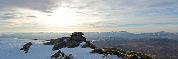 Photo of Erin's cairn, Ben Hope with western hills beyond