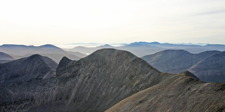 Photo of an autumn view south from Foinaven's highest top Ganu Mor over the southern section of the Foinaven ridge to a host of hills beyond
