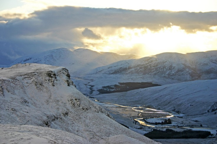 Photo of a snowy December view south down wild, remote Strath More to Ben Hee from the slopes of Ben Hope