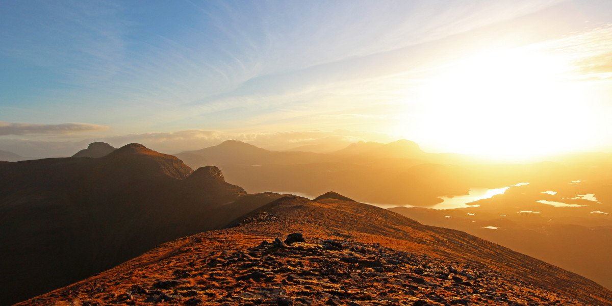 Photo of afternoon light over Assynt from Quinag's Sail Ghorm