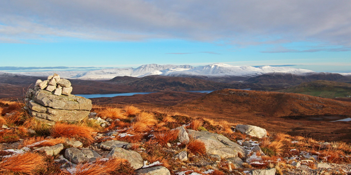 Photo of the Assynt giants of Conival and Ben More Assynt from the eastern slopes of Cul Mor