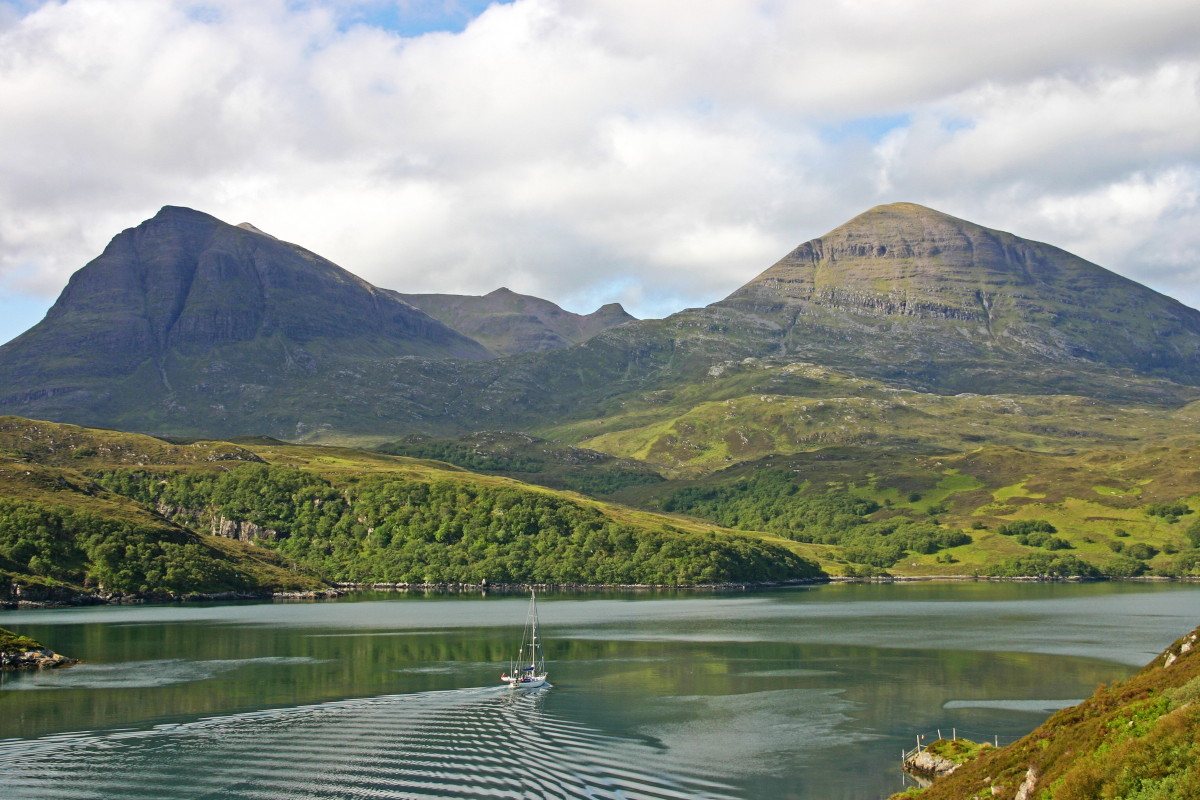 Photo of Quinag seen across the waters of An Caolas Cumhang and Loch a' Chairn Bhain from close to the Kylesku Bridge (Drochaid a' Chaolais Chumhaing)