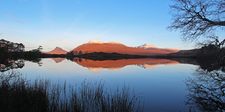 Photo of Stac Pollaidh, Cul Beag and Cul Mor reflected in the water of Loch Cul Dromannan on a winter morning
