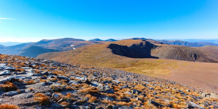 Photo of an autumn view from near the summit of Cairngorm to Ben Macdui, left of centre, Cairn Toul, Angel's Peak and Braeriach are the distant peaks in the centre. Stob Coire an t-Sneachda and Cairn Lochan are in the foreground.