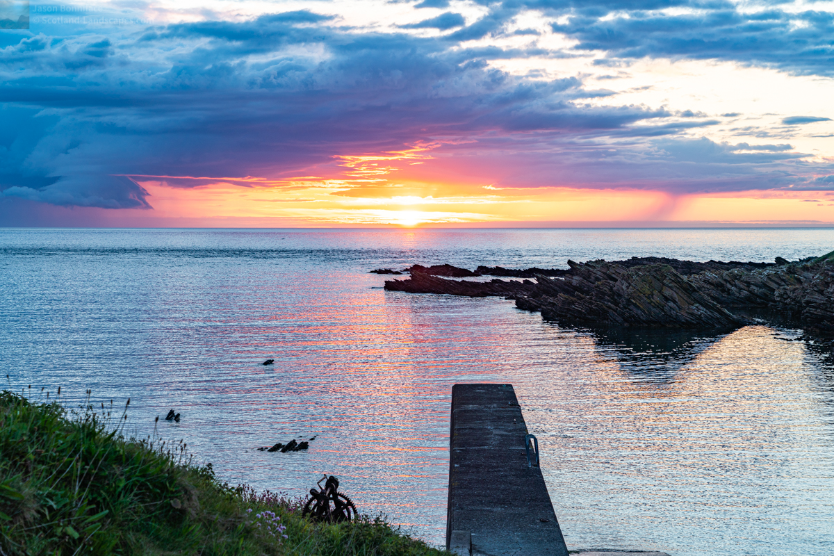Photo of the jetty at the tiny Scarfskerry Harbour on the Caithness coast of the Pentland Firth