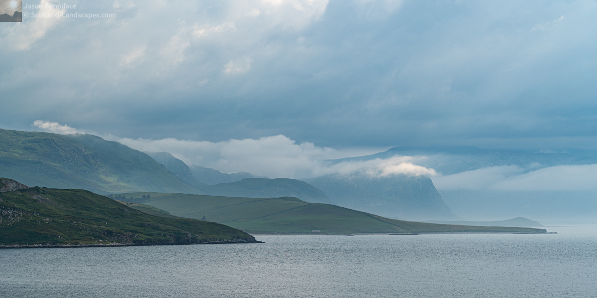 Photo of A telephoto view of the misty eastern shore of Loch Eriboll