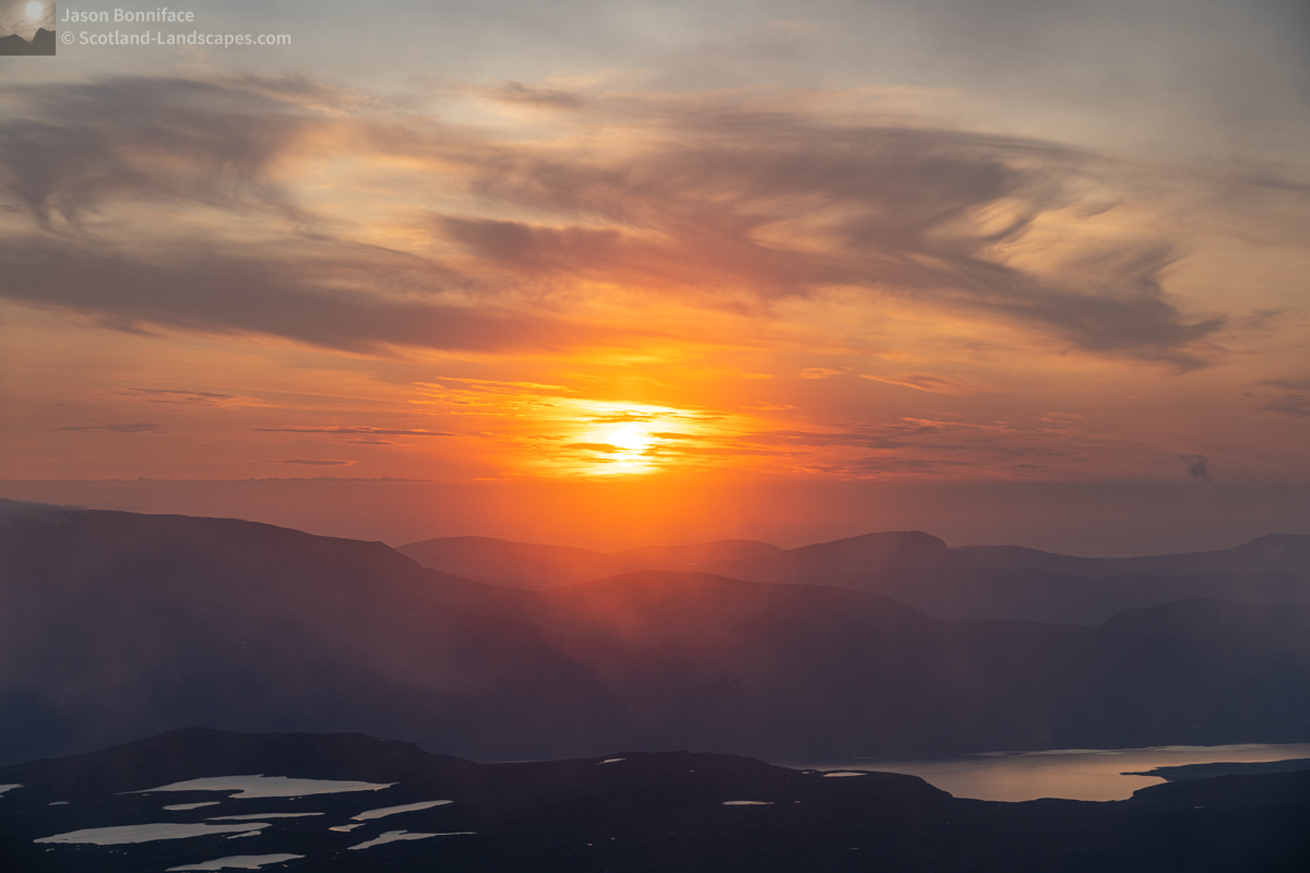 Photo - The sun heading down towards the clouds over Cape Wrath